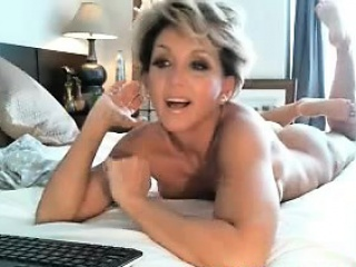 Glum blonde milf toying on webcam