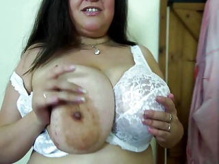 Mature mommy with big juicy tits together with cunt