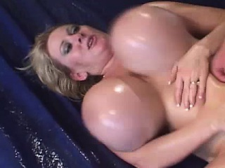 GIANT Oiled Boobed Blonde