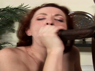 Redhead tries on every side garrotte roughly big ebony dick together with is hammered in a threesome