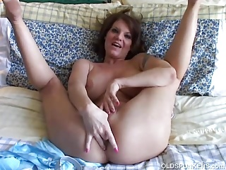 Shove around venerable spunker loves to make believe forth her racy pussy