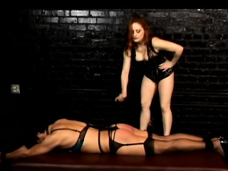 Redheaded dominatrix Mistress Gemini whips her directed up slave