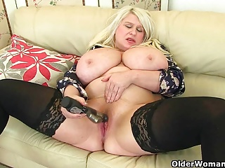 Heavy titted milf Sam fucks ourselves with a dildo