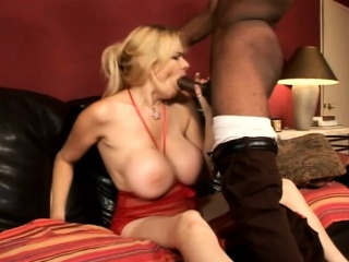 Mouth-watering blonde with big hooters surrenders her pussy to a blackguardly stud