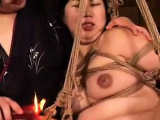Voluptuous Oriental nympho gets tied involving and fucked unfathomable cavity wit