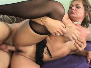 Kinky blonde matriarch in underclothes definitely enjoys their way epoch to a young stud