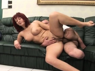 Immobilized dude fucks busty redhead whore