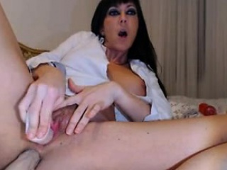 Brunette milf puts a dildo on the pest with the addition of pussy