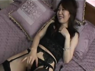 Provocative Japanese babe in X lingerie touches herself
