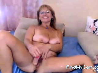 Blonde amateur MILF rides a dildo on webcam