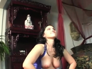 Strapped person smothered by a pair of coarse dominas