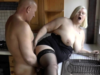Busty gran in stockings gobbles cock