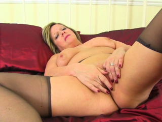 English milf Lucy Gresty needs getting off in satin