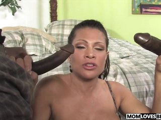 Teri Weigel takes two black cocks onwards be useful to her lass
