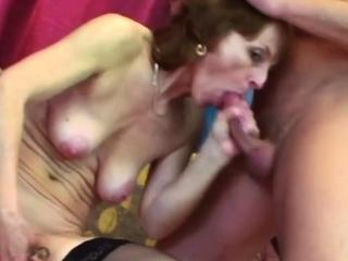 Horny granny is sucking this man's crap while masturbating.