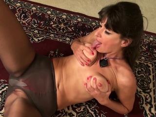 Nyloned milf Natasha masturbates with finger in bore