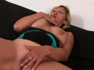 Sizzling GILF is deep throating a BBC in will not hear of living room.