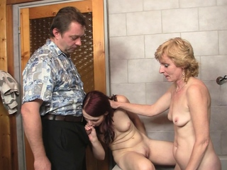Mom licking coupled with toying her young hole winning 3some