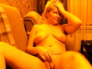 Down in the mouth Russian mature mom masturbate on sofa