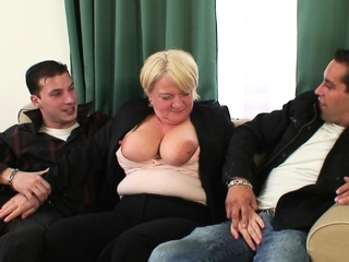 Old whore rides two cocks