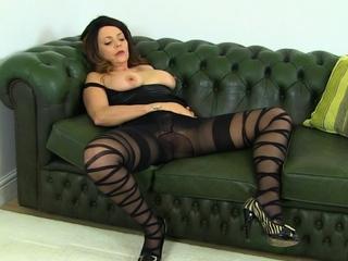 English mature Sophia puts dildo to simulate
