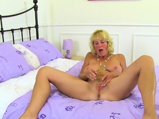 Mature tow-headed Molly gets excited in nylon tights