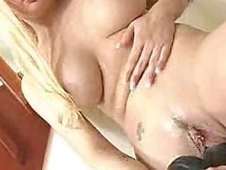 Busty blonde Tatiana Stone effectuation with black dildo