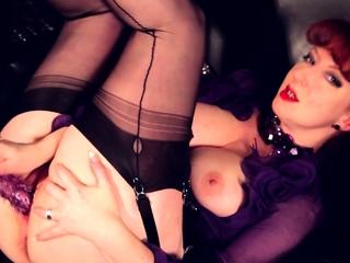 Horny redhead MILF Red XXX fucks her purple toy