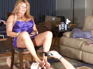 Step-mom gives cuck furtive footjob