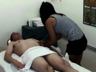 Asian masseur rubs down unmask client